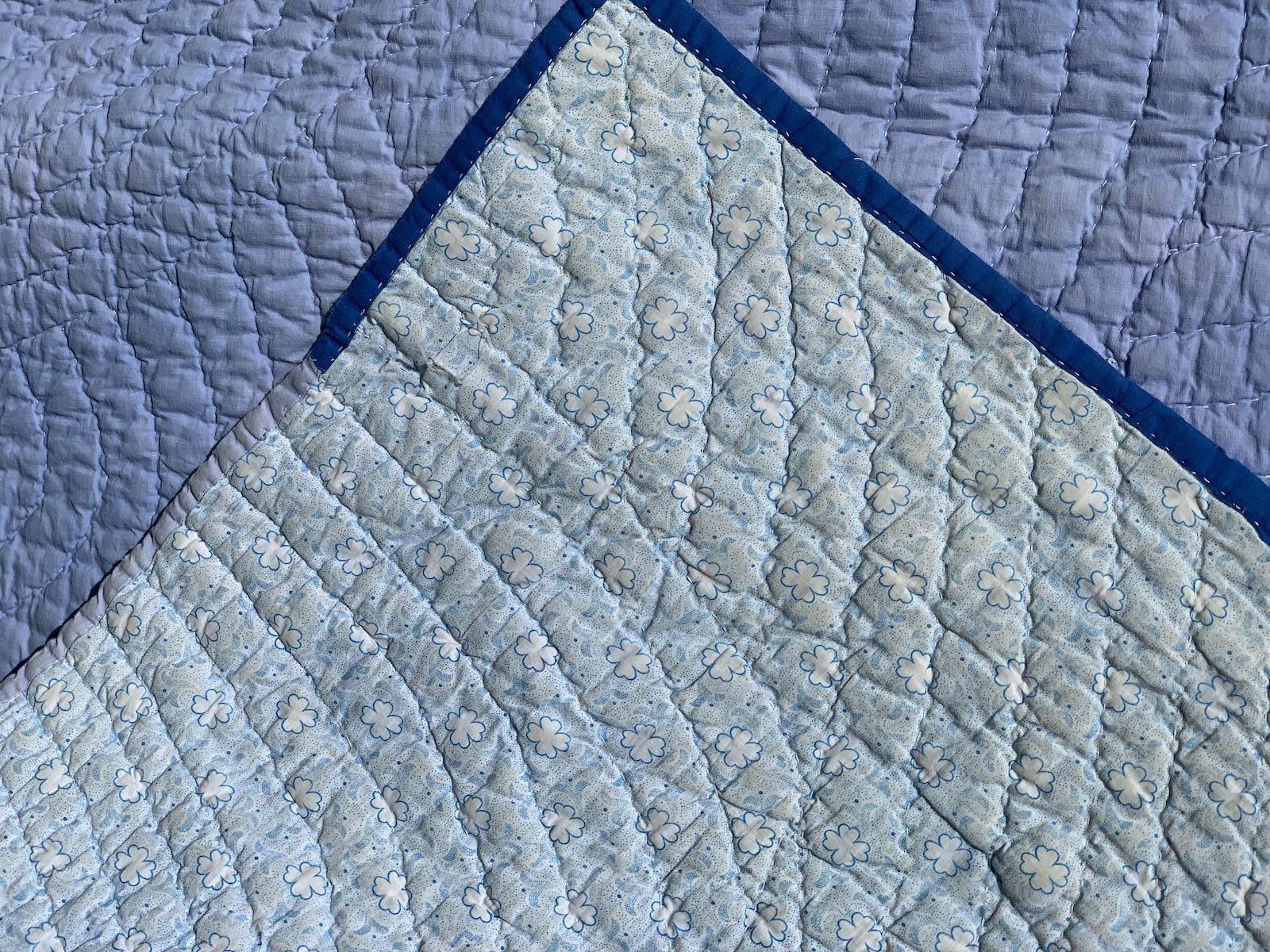 1-corner of quilt flipped over turned