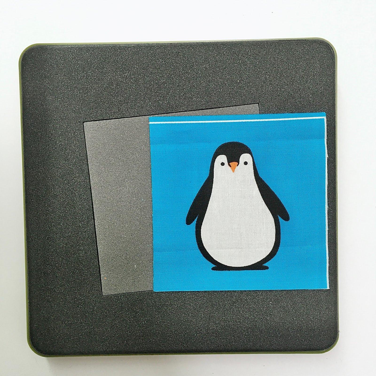 10-Penguin fabric on square die