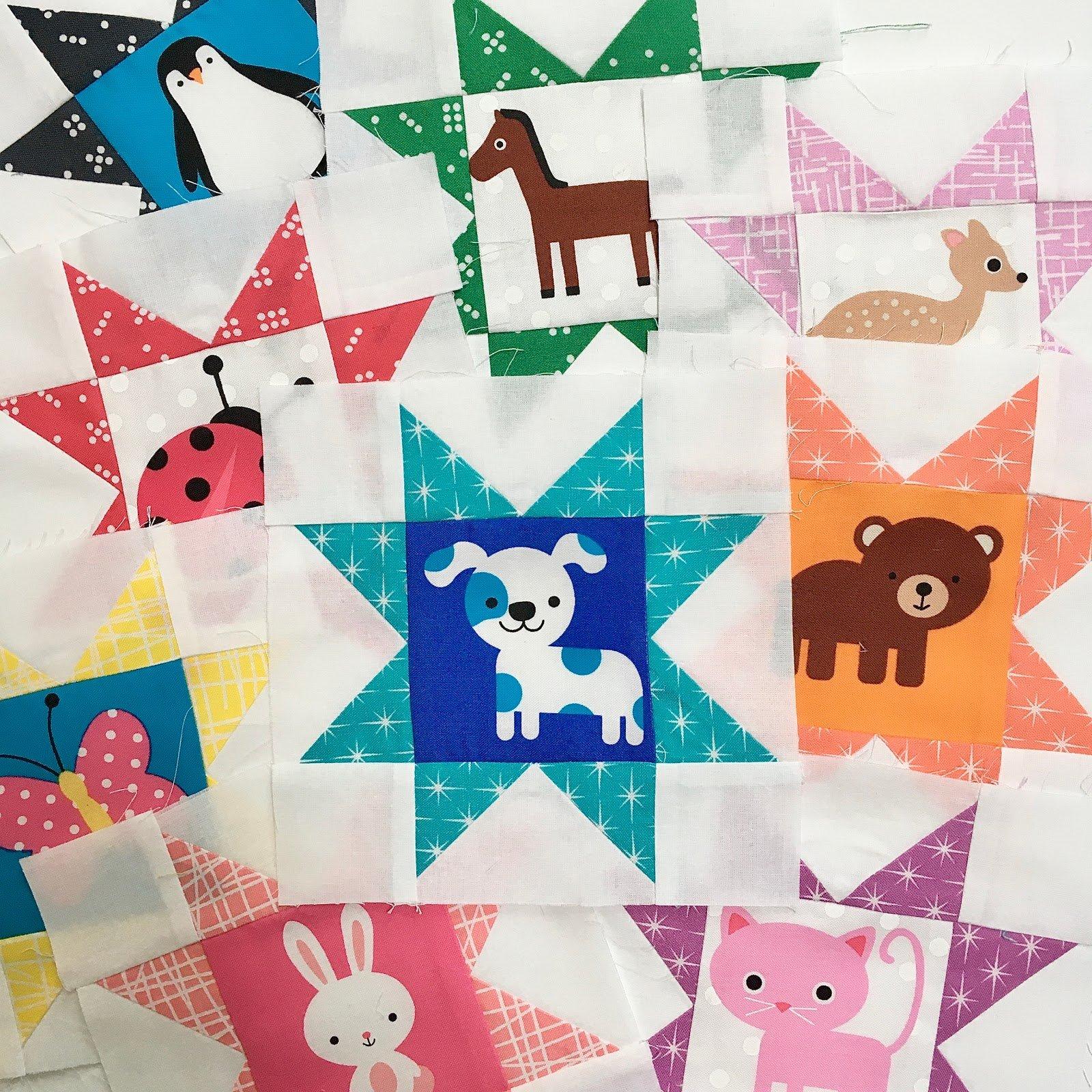 15-sawtooth star quilt blocks with animals in center block