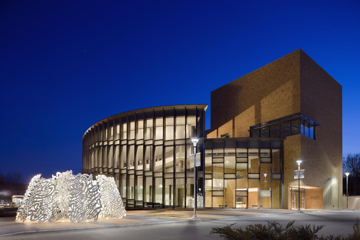 Night time photo of the external structure of the International Quilt Museum - Photo by International Quilt Museum