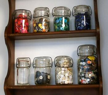 Button jars organized by color