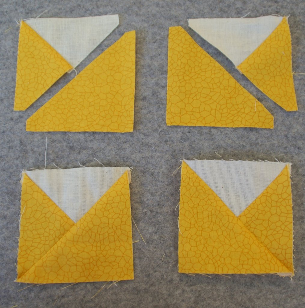 white triangle with yellow triangles as sunflower petal blocks sewn