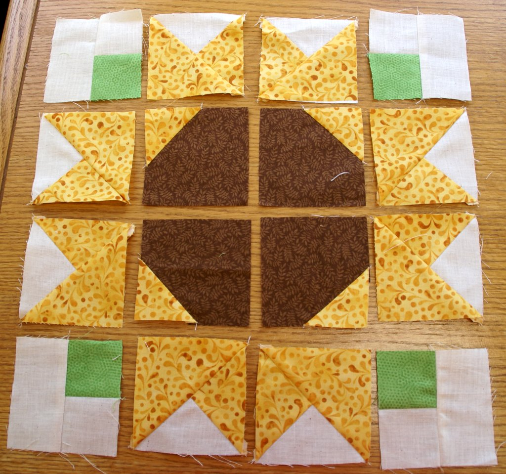 sunflower block laid out on sewing table before sewn together
