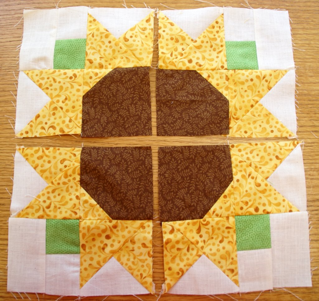 sunflower block sewn into squares and laid out before sewing