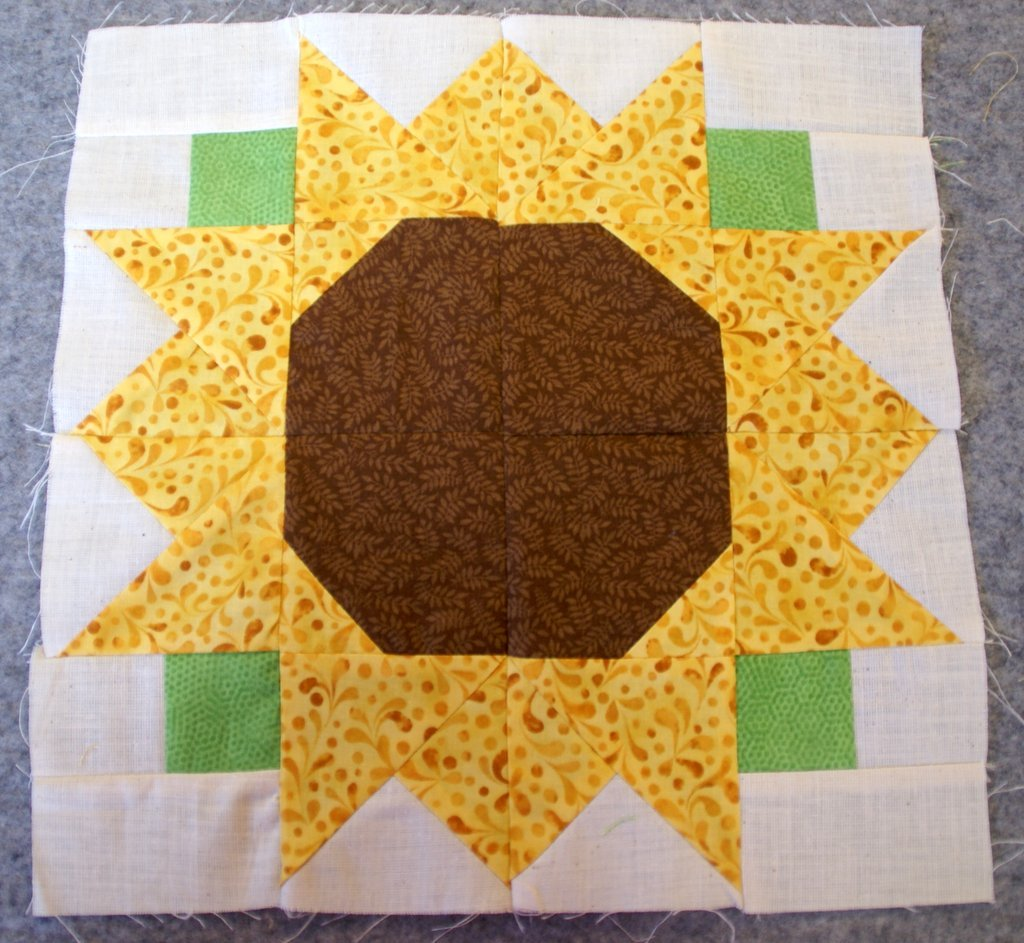 sewn sunflower block on wool mat