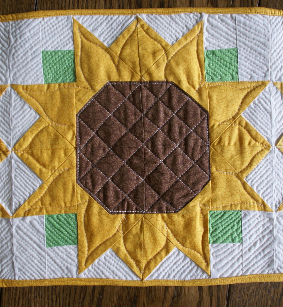 close up of completed sunflower block with detailed quilting