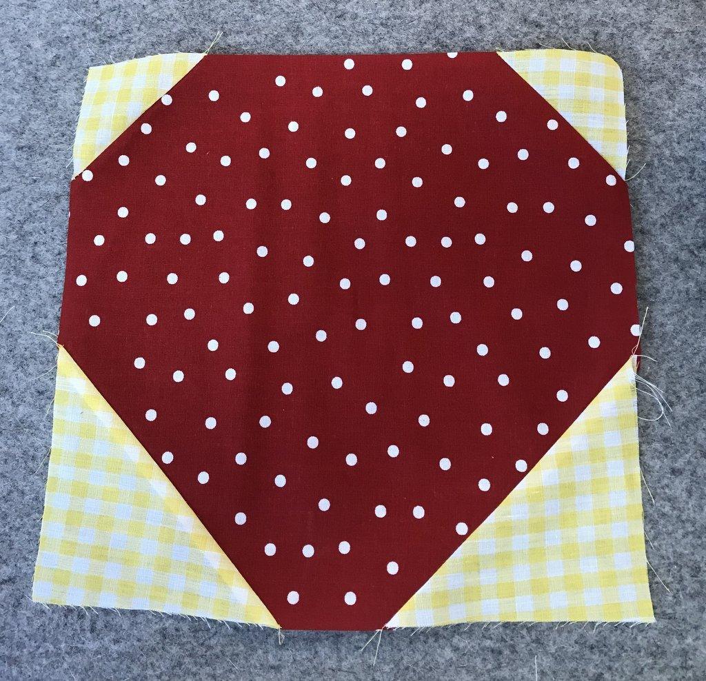 sewn red and white polka dot strawberry block