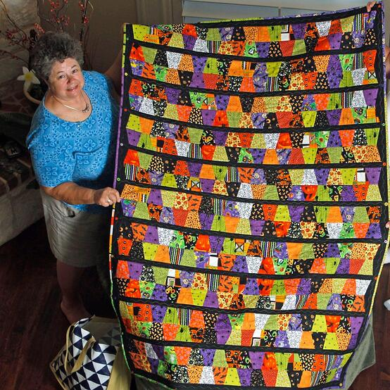 Mary with her Halloween Tumbler Quilt