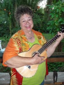 Mary holding her new Oscar Schmidt baritone ukulele