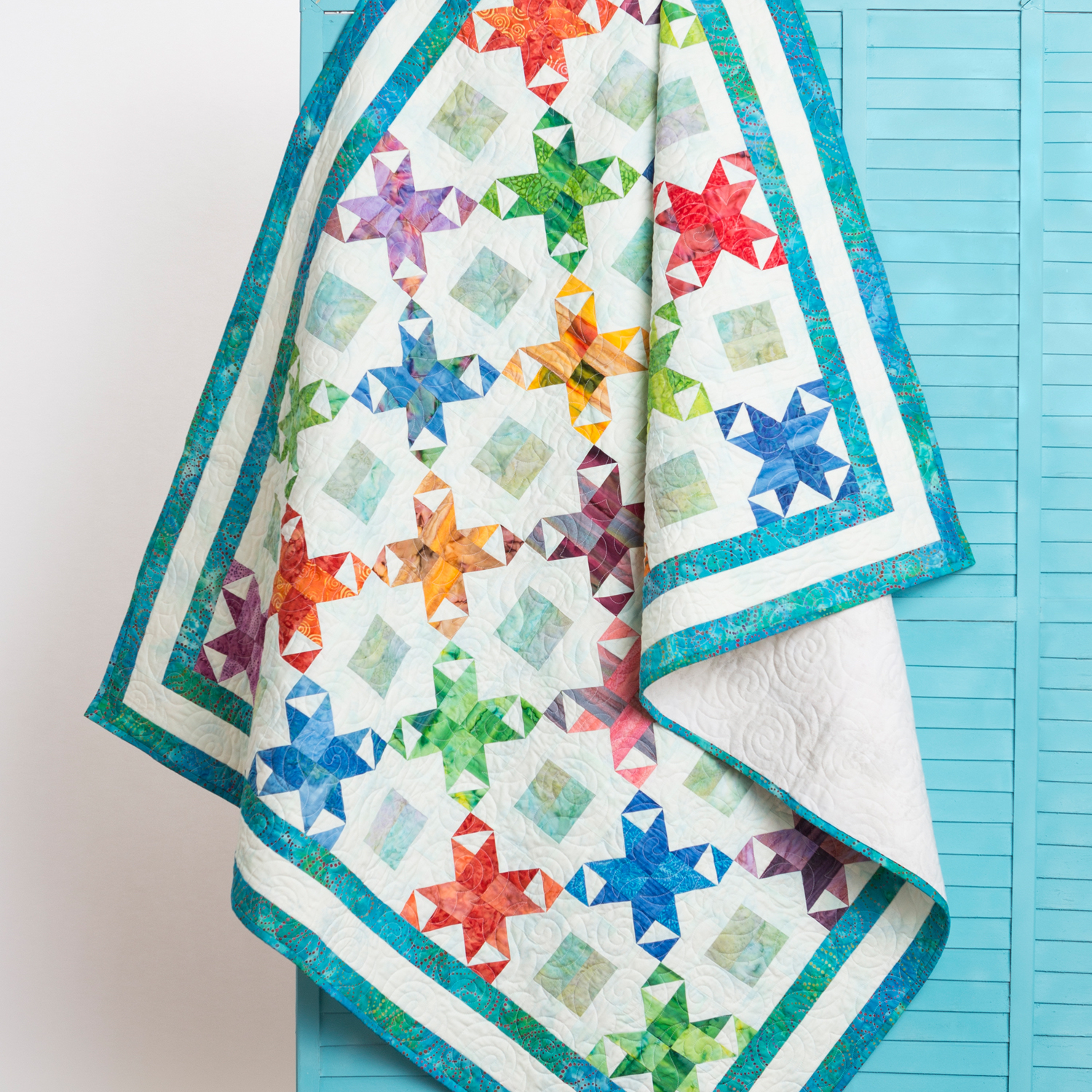 PQ11035-6in-star-surprise-throw-quilt-lifestyle-1500x1500
