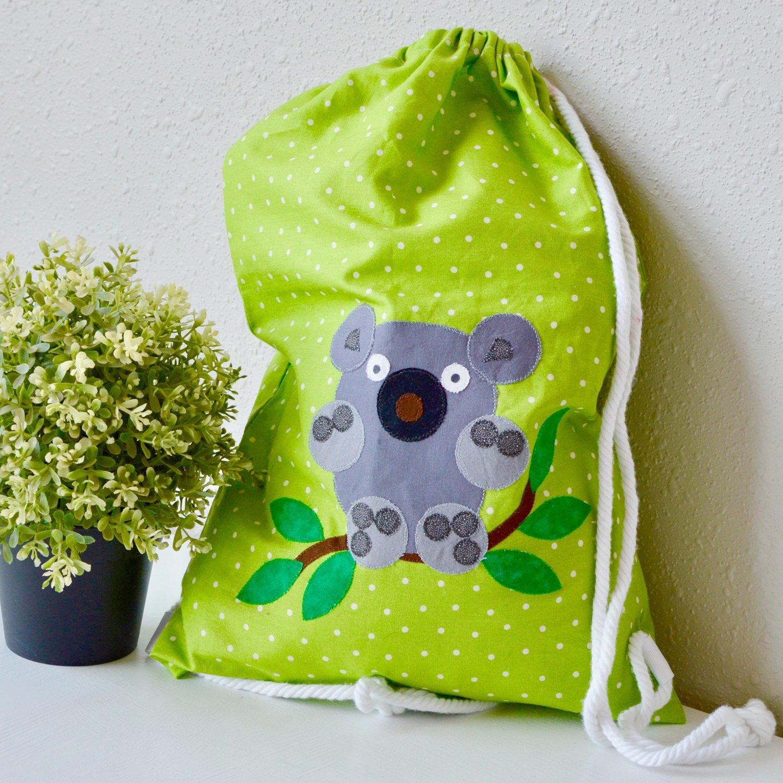 PQ11557-cuddle-me-koala-cinch-bag-lifestyle-1500x1500-blog