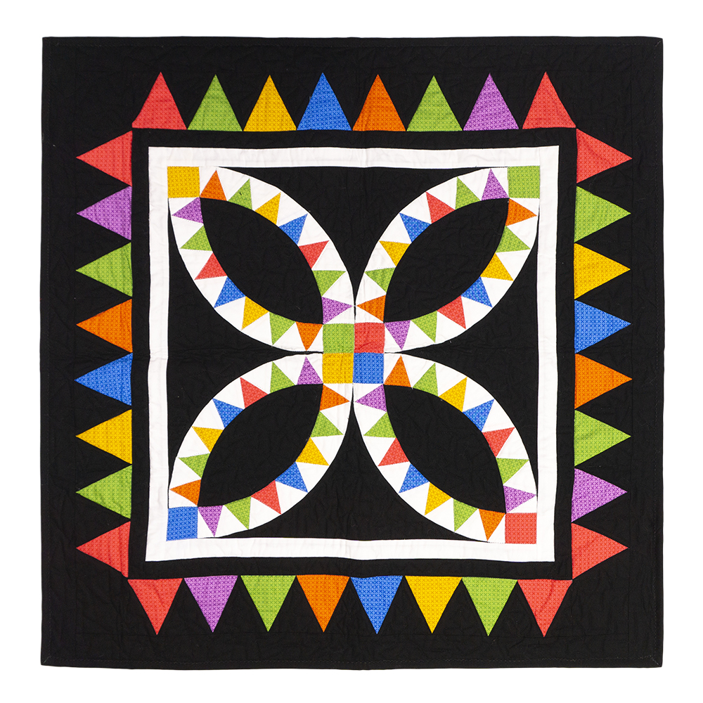 GO! Pennant Mania Throw Quilt displayed featuring a black background and a rainbow of colors