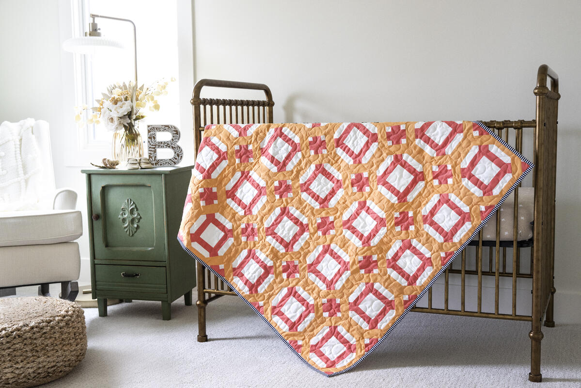 PQ11892-Round-A-Bout-Throw Quilt-lifestyle-hor-HQ