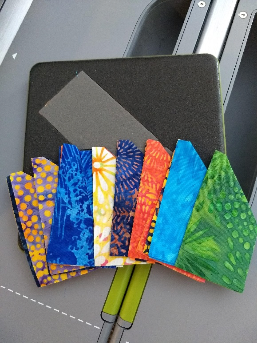 Cut fabric in bright batik fabrics on a GO! die and GO! fabric cutter.