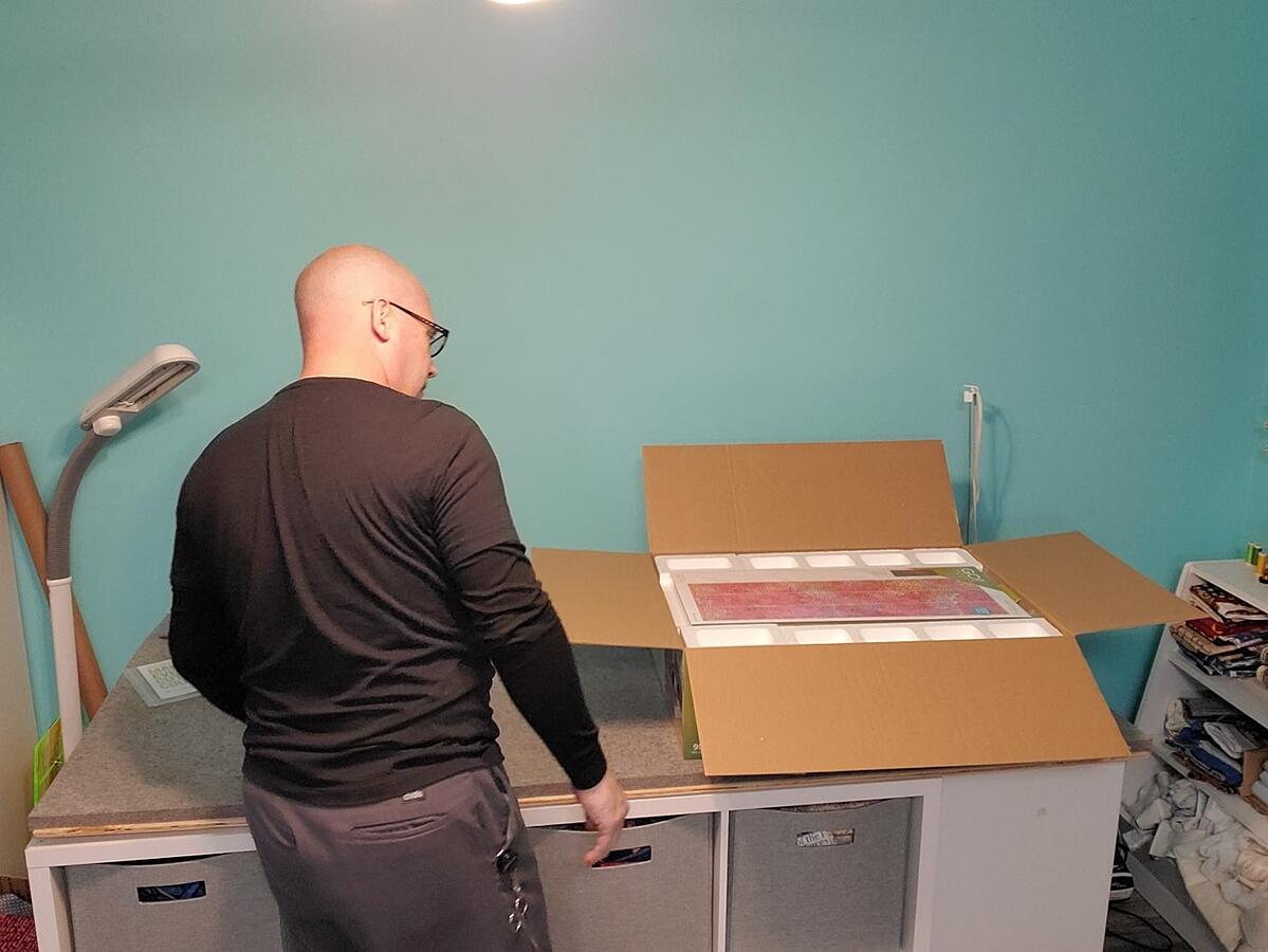 Andrew opens the box and realizes how much in included in the Ready. Set. GO! fabric cutting system