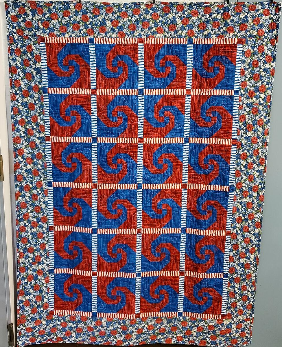 Red, white and blue themed quilt using the GO! Snail Trail dieusing