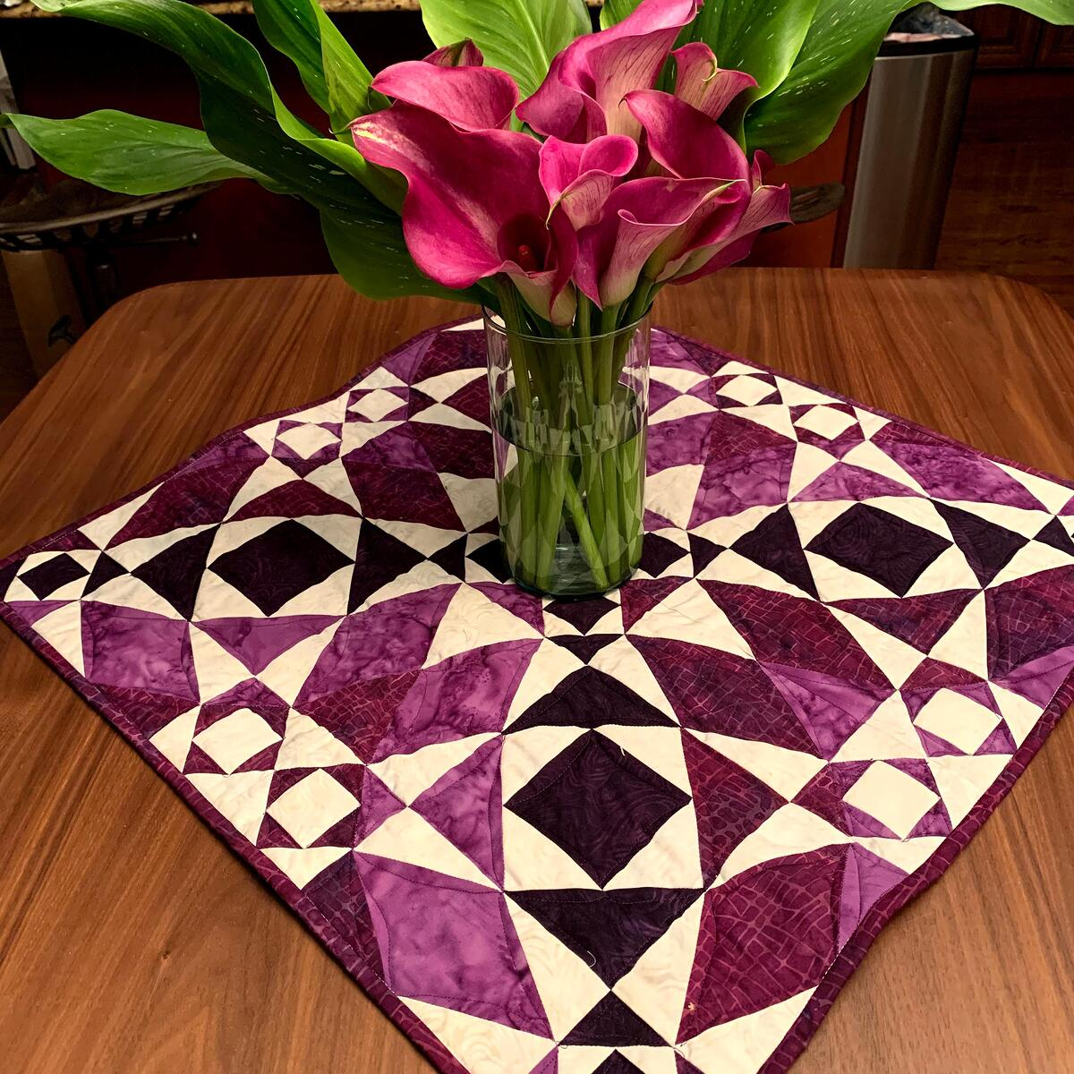 Purple Storm at Sea Quilt with calla lillies