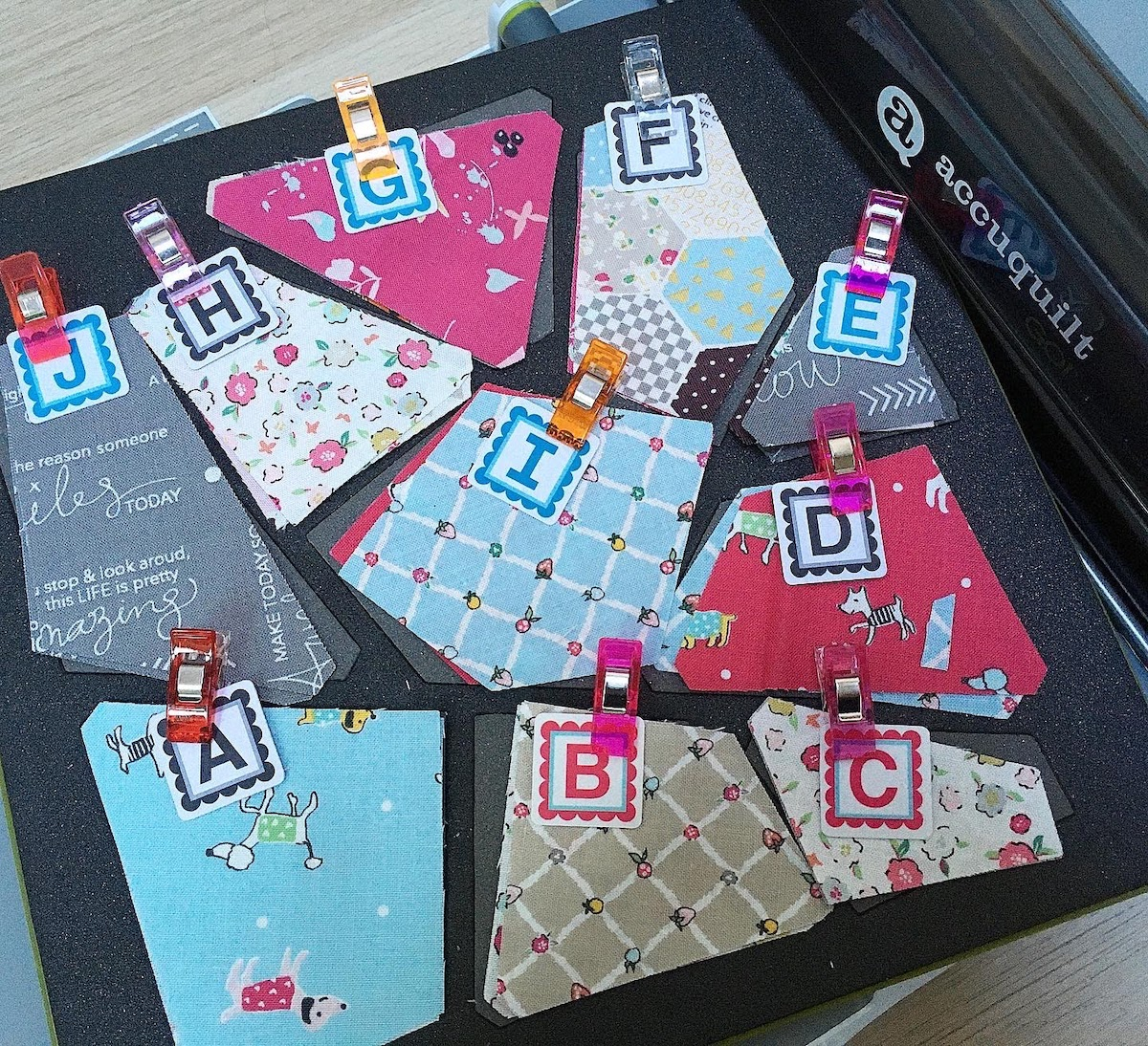 labeled fabric pieces cut on GO Crazy Quilt Block AccuQuilt die on AccuQuilt GO fabric cutter