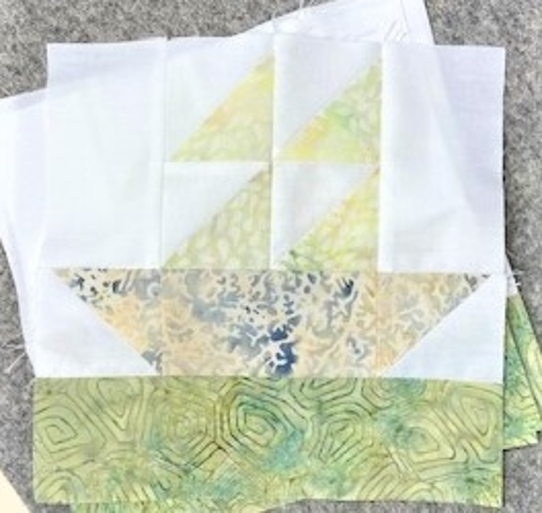 "pieced sailboat quilt block made with accuquilt go! mix & match qube 8"" and island batik green, yellow and solid white fabrics"