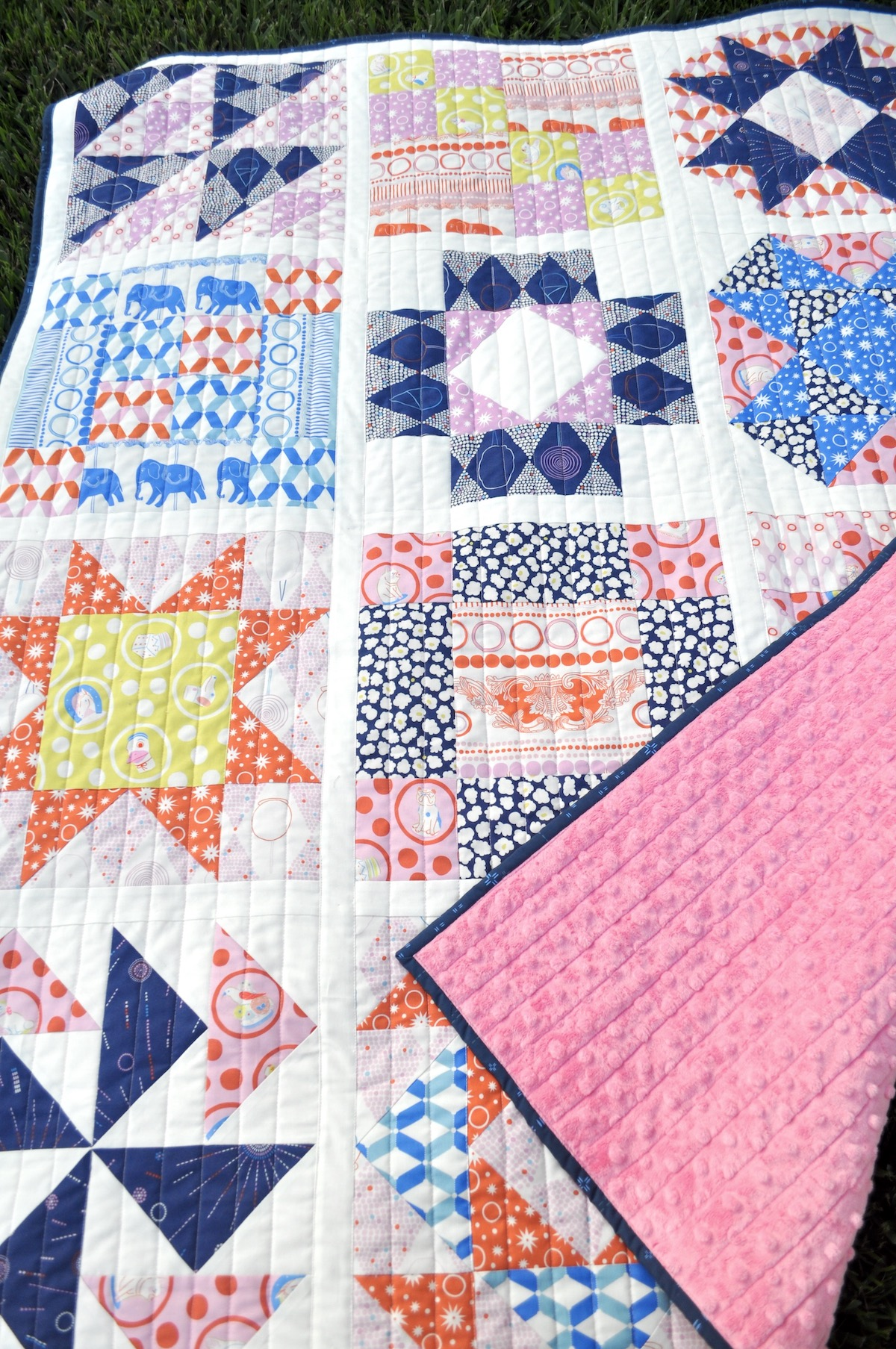 sampler blocks quilt with straight line quilting with Ring Toss FIGO Fabrics and a pink cuddle backing