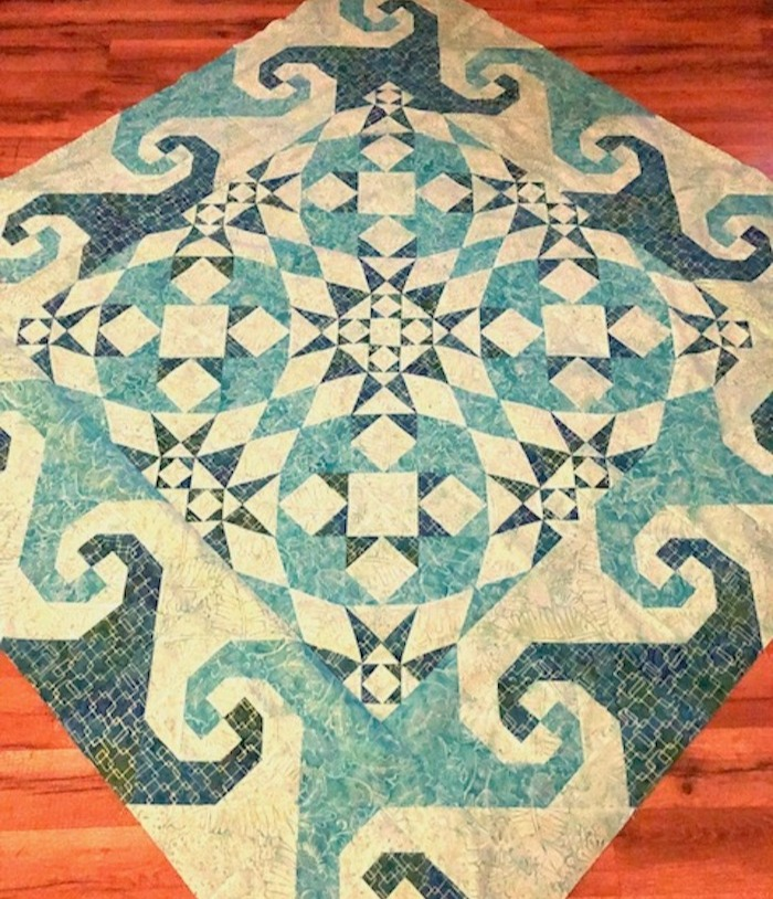 storm at sea1-unsandwiched snails trail + storm at sea quilt top wooden floor-1