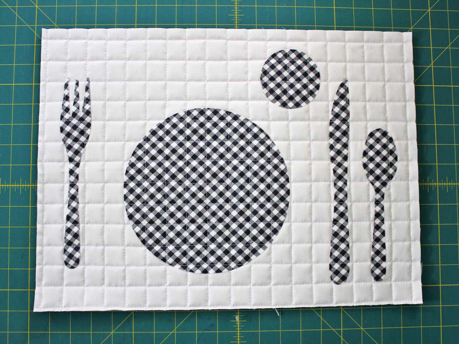 quilted and trimmed table setting placemat