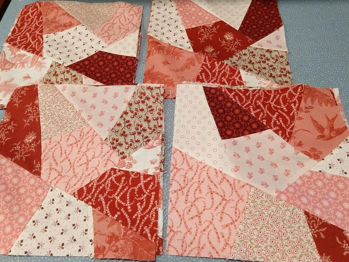 pieced crazy quilt red, pink, beige