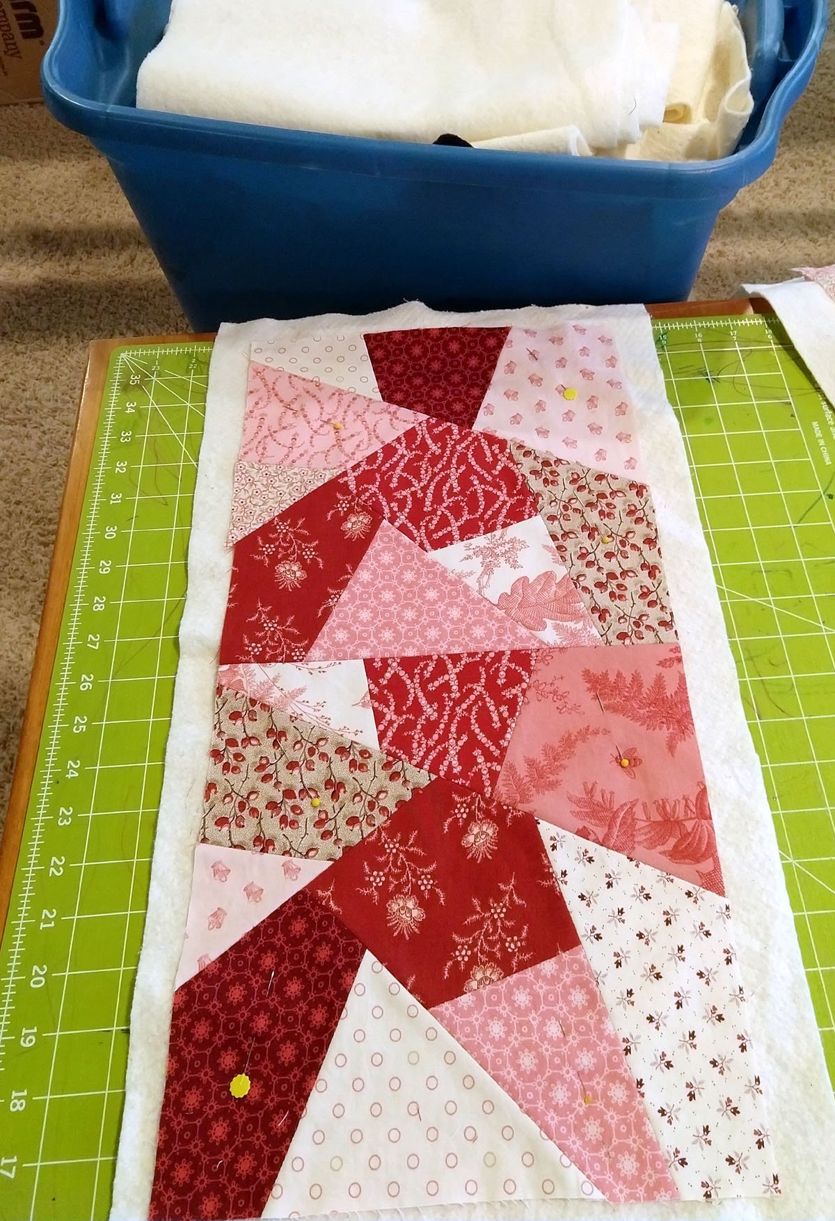 two crazy quilt blocks sewn together over batting