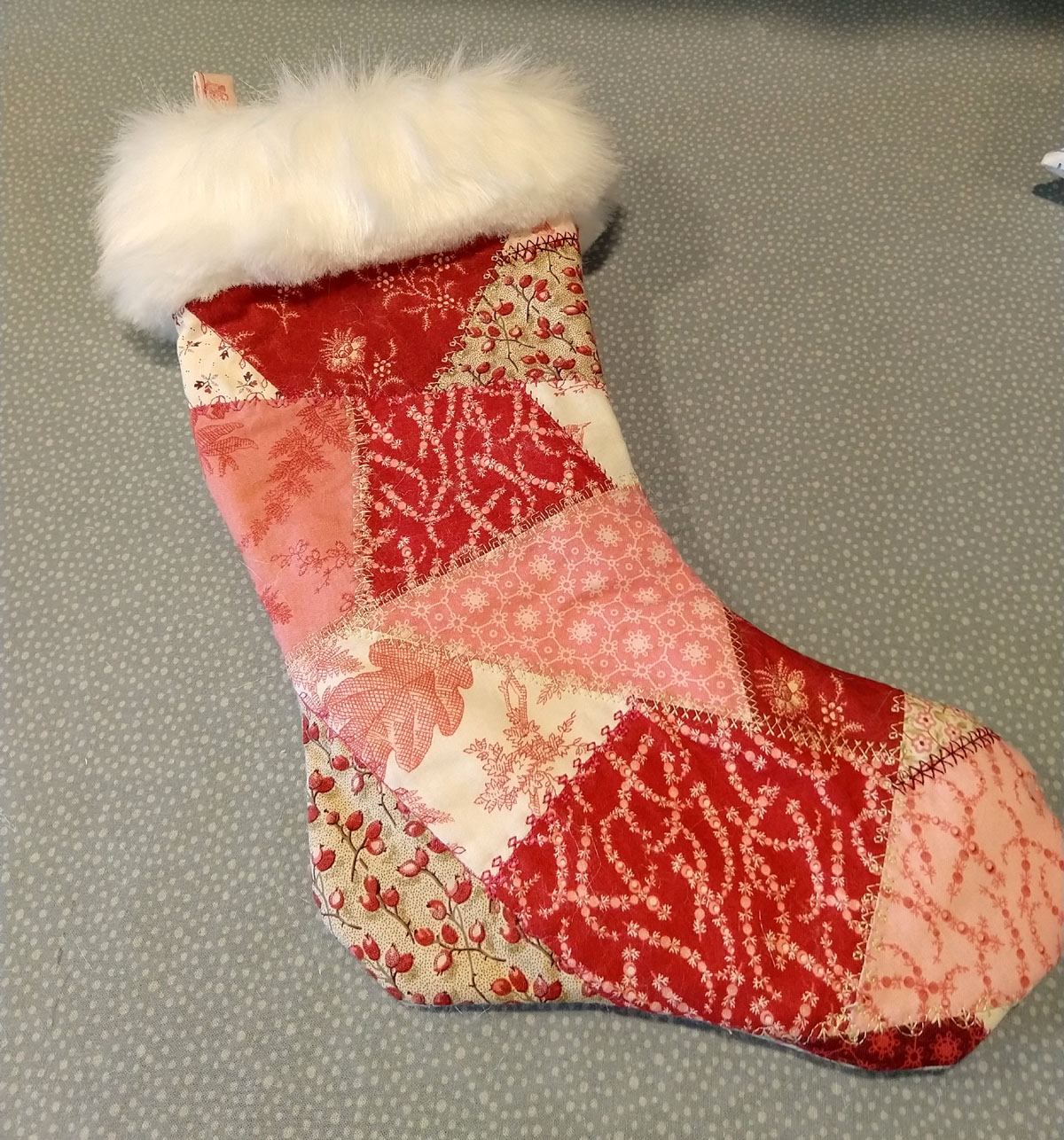 completed patchwork stocking with fur top