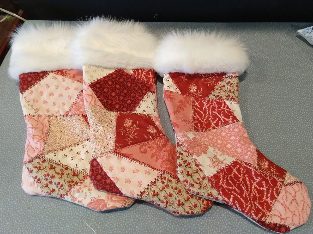 3 completed scrappy stockings