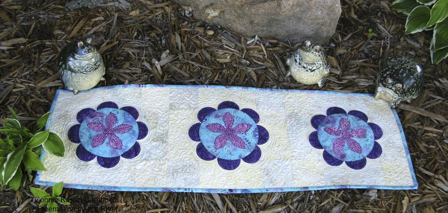 Table runner outside with some frogs