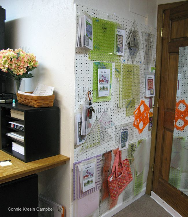 Rulers and templates hanging on pegboard
