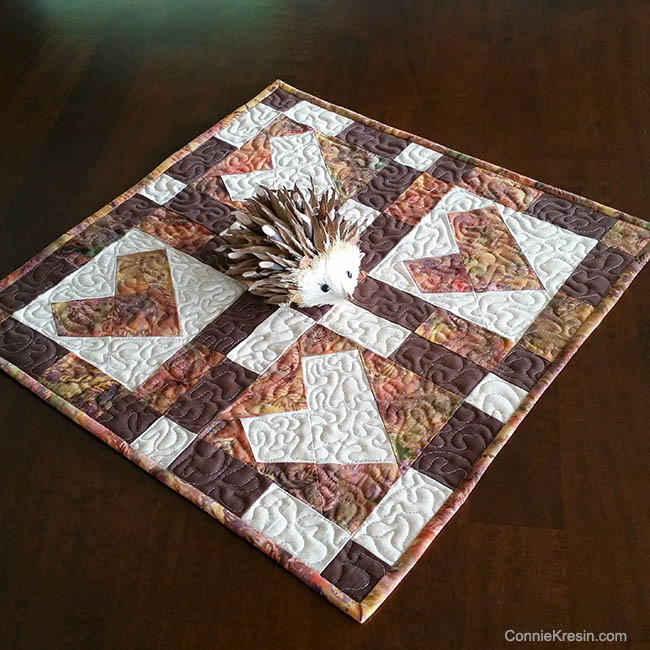 You now have a cute little Wonky Heart Autumn Table Topper for your table.