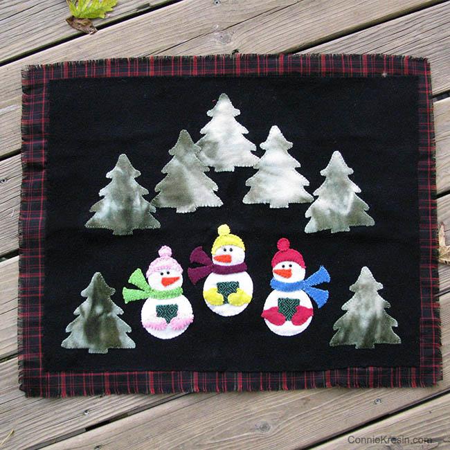 AccuQuilt GO! die Caroling Snowmen in the woods