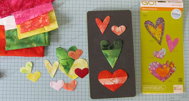 Scrap fabrics for the AccuQuilt Queen of Hearts Pillow tutorial