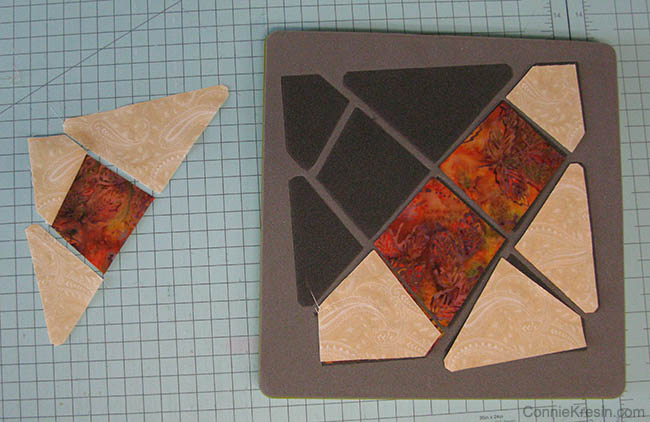 Start with the top left corner and sew the sections together. You will join the center two first.