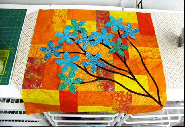 Fuse the applique pieces to the background