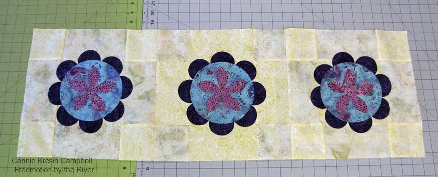 Fuse the AccuQuilt GO! flowers to the table runner