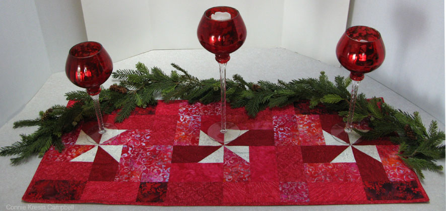 AccuQuilt holiday quilting with Christmas Pinwheels table runner