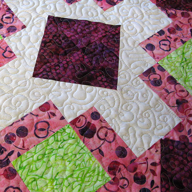 Churn Dash Medallion topper quilt with free motion quilting