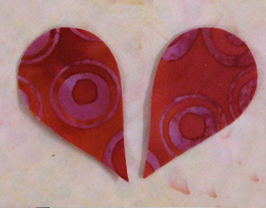 Use the AccuQuilt GO! Feather die to create batik hearts