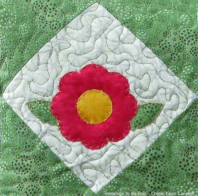 Closeup of applique on rose and petals