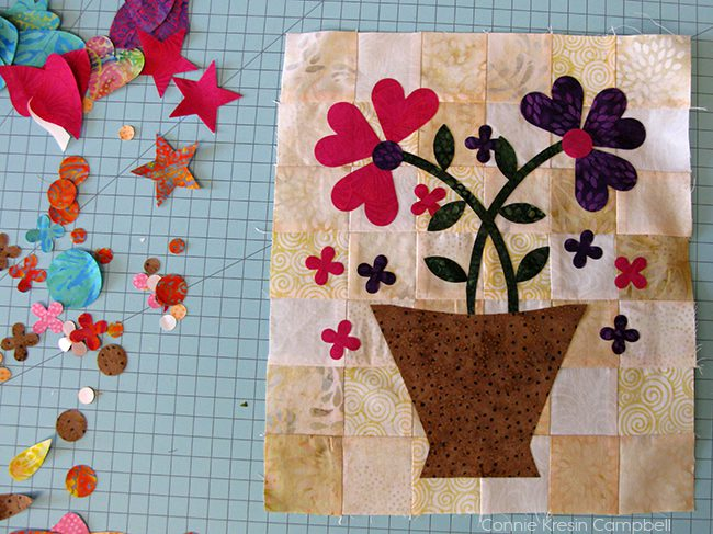 Appliquing the Specialty Flower Basket mini quilt