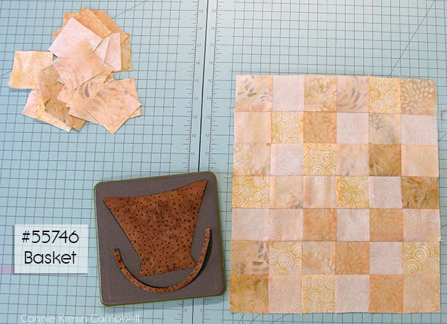 Add the die cut baskets to the mini quilt top