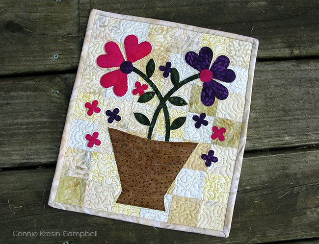 Serendipity flowers mini quilt on the deck