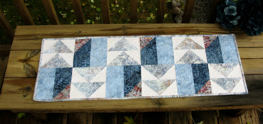 Winter Blues table runner made with AccuQuilt Go dies