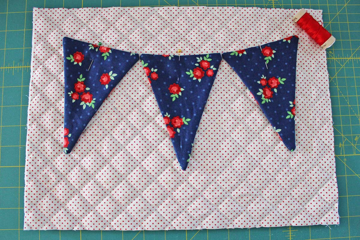 Step_6_pin pennants on quilted background