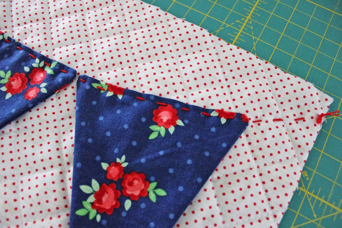 Step_7_sew pennants on with running stitch